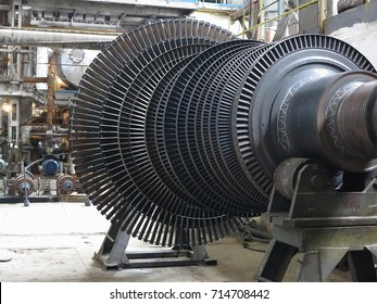 Power generator steam turbine during repair at power plant.
