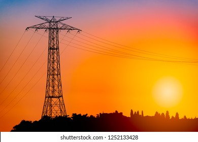 Power grid pylon against orange sunset sky in Istanbul, Turkey