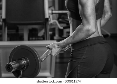 Power gym workout, women workout. Beautiful blonde trains in the gym