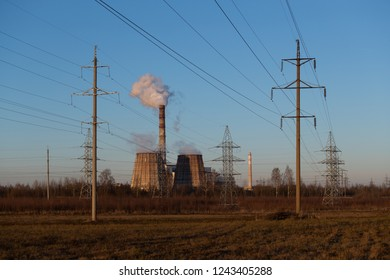 Power indusrial. Thermal Power Plant. Industrial landscape. Pipes of the power station smoke against the blue sky. Sunlight