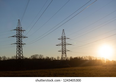 Power industry. Industrial landscape with high voltage power lines. Sunlight
