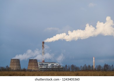 Power industry. Thermal Power Plant. Industrial landscape. Pipes of power station smoke on the background of the cloudy sky