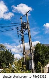 Power line concrete pole end with cables falling vertically. Power Line Concrete Pole End with Vertically Falling Cables and a Height Transformer