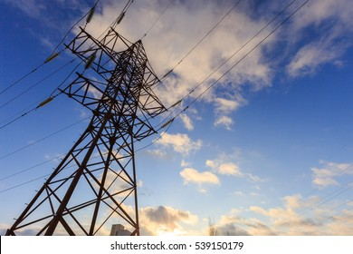Power line. High voltage post. High-voltage tower over sky background at sunset or sunrise at winter.