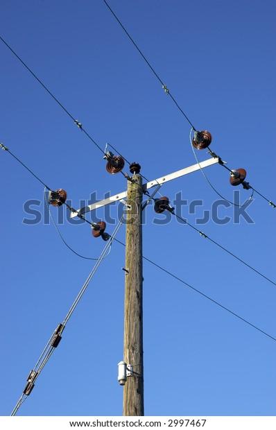 A power line on a blue sky