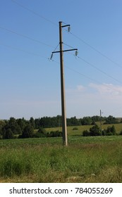 power line in an open summer field. beautiful summer landscape with nature of Russia