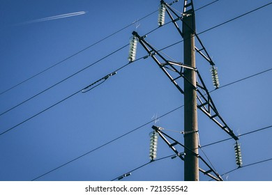 Power line posts against the clear blue sky