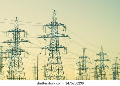 Power line posts. high voltage tower with the sky. industrial background
