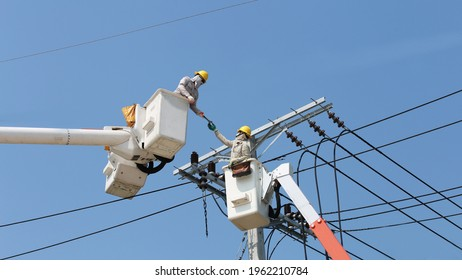 Power line support, insulators and wires. Appearance of a design. Assembly and installation of new support and wires of a power line. electricians repairing wire on electric power pole.  - Shutterstock ID 1962210784