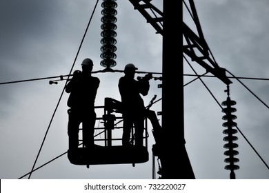 Power line support, insulators and wires. Appearance of a design. Assembly and installation of new support and wires of a power line.