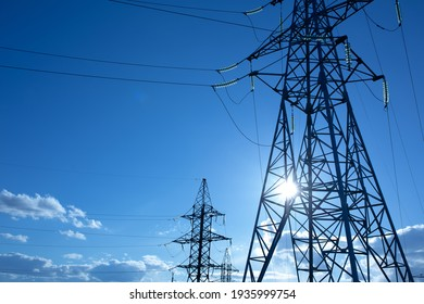 power line support with wires for electricity transmission. High voltage grid tower with wire cable at distribution station. energy industry, energy saving