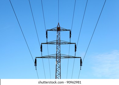 Power line tower against blue sky
