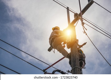 The power lineman is replacing the damaged insulator. That causes a power outage with protective equipment that is insulated and wearing personal protective equipment such as safety belt, helmet.