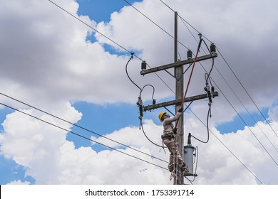 The power lineman use clamp stick (insulated tool) to closing a transformer on energized high-voltage electric power lines. The power lineman must be trained because it is a risky job.