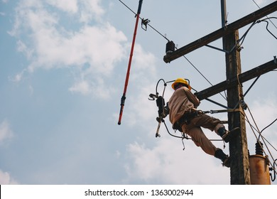 The power lineman uses insutated tool to open the connection of the transformer from the high voltage distribution system. To change the surge arrester that protects the transformer.