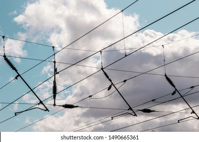 Power lines above a railway track that supply energy to the trains that run along the line.