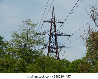 Power lines in the city, strained wires on a metal structure