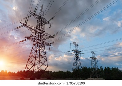 Power lines during a beautiful sunset. Electricity transportation on beautiful landscapes of the world.