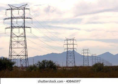 Power lines fading off into the distance, heading towards mountains.
