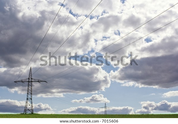 power lines in front of a cloudy sky