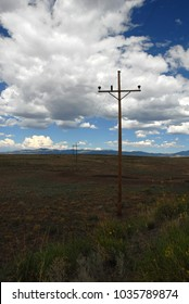 Power lines in the middle of nowhere sending electricty to remote locations.