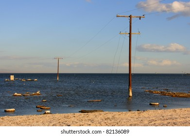 Power lines to nowhere at Salton Sea Beach.  I believe there was once a resort at the other end of these telephone poles.