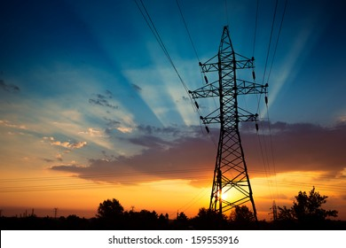 Power lines on a colorful sunrise