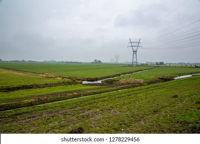 Power lines on a muddy field