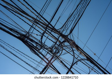 Power lines organized mess and clear blue sky in Tokyo.