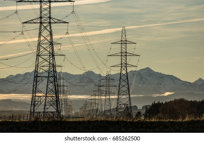 Power lines with snowy mountains.