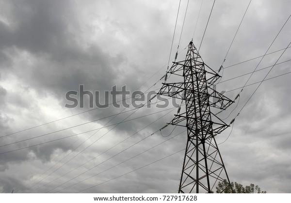 power-lines-stormy-sky-600w-727917628.jp