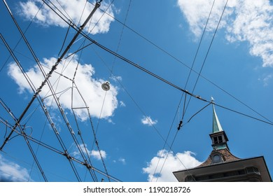 Power lines for street cars with blue sky in Bern
