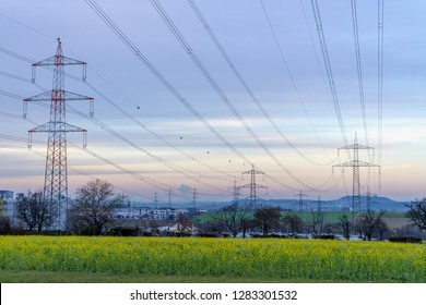 power lines at sunset, overhead power line pylon, power line pylon with ground wire, equipment for overhead power line pylons