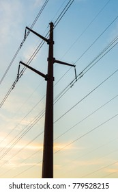 Power lines supported by steel lattice towers transmit electricity across long distances.