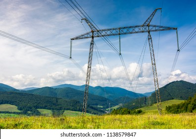 power lines tower on a meadow against the blue sky. lovely energy industry background. efficient electricity delivery concept. beautiful and bright cloudscape
