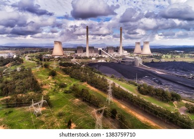 Power lines transmitting electricity away from Bayswater power statiion burning fossil black coal fuel in the middle of Hunter Valley, Australia NSW.