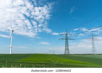 Power lines and a wind turbine seen in rural Germany