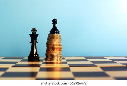 power of the money concept. Chess pawn standing on the money over the king