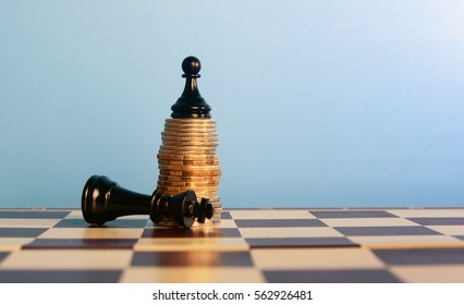 power of the money concept. Chess pawn standing on the money winning  the king