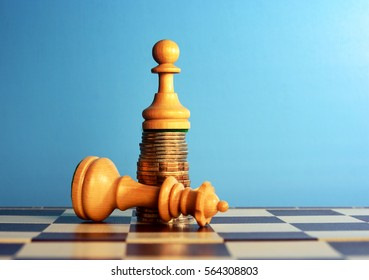 power of the money concept. Chess pawn standing on the money over the queen