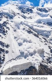 Power of nature. Real powerful avalanche comes from a big mountain, Caucasus, Kabardino-Balkaria, Bezengi region, Russia