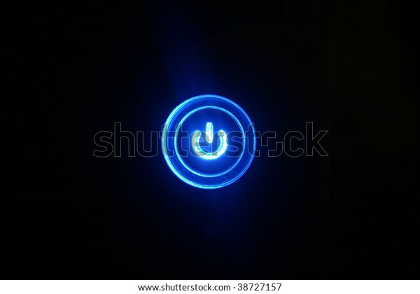 Power on - Blue glowing button on black background