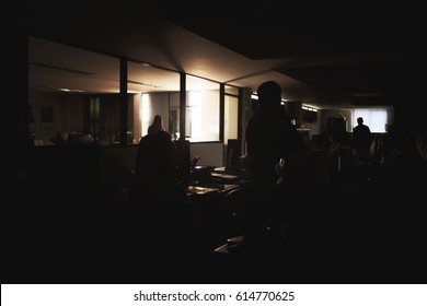 power outage at the office with soft-focus in the background. over light