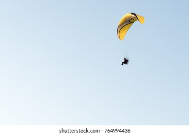 """Power paraglidingI photographed November 12, 2017.It was taken at the place called """"Tando Port"""" of the Republic of Korea. It is before sunset."""