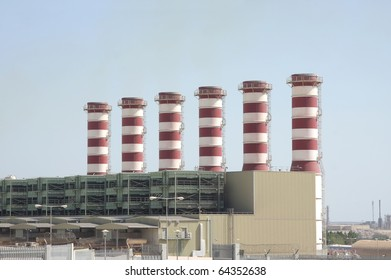 Power plant chimneys in Bahrain with almost no greenhouse gases