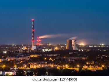 Power plant chimneys, evening Krakow, Poland