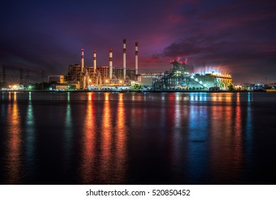Power plant at dust with reflection over the river