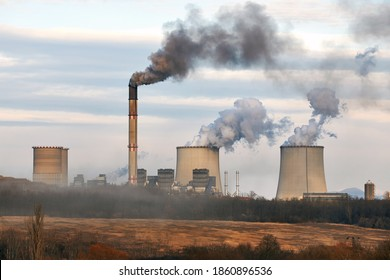 Power plant emiting dark thick smoke and steam. Matrai eromu, Mátrai Erőmű, Visonta, Hungary