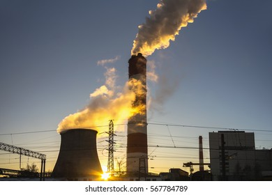power plant emitting smoke and vapor in cold weather,