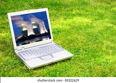 power plant in laptop or notebook screen showing energy supply concept